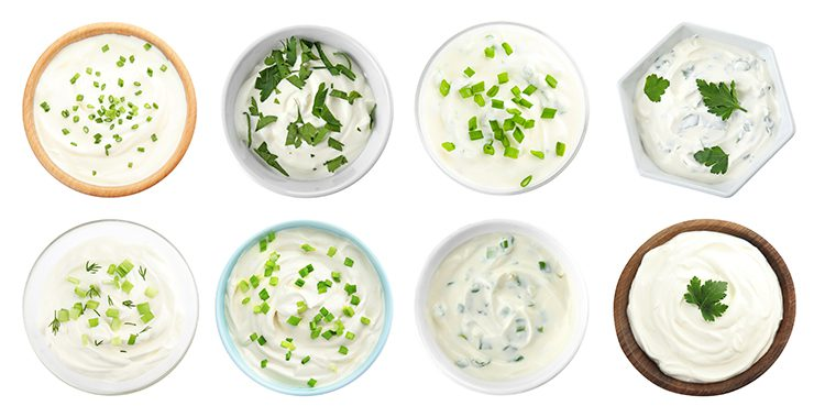Different types of sour cream in different bowls