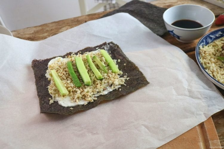 nori sheet with cream cheese, cauliflower rice, avocado and cucumber slices