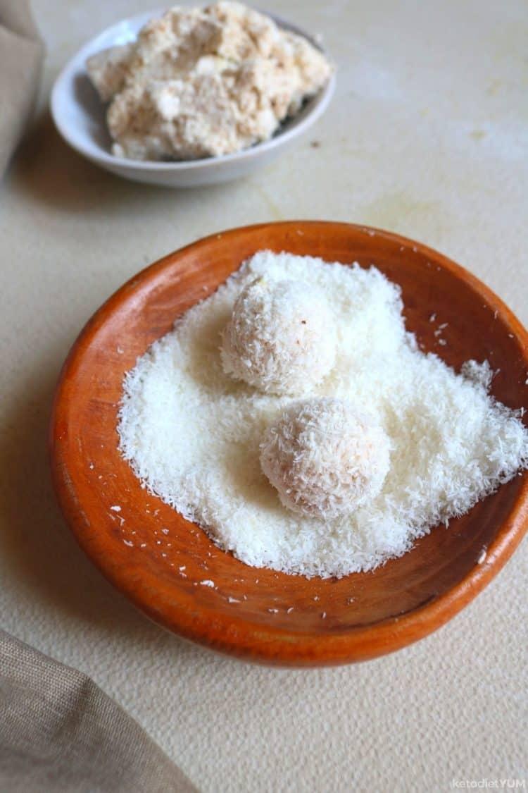Rolling fat bombs in shredded coconut