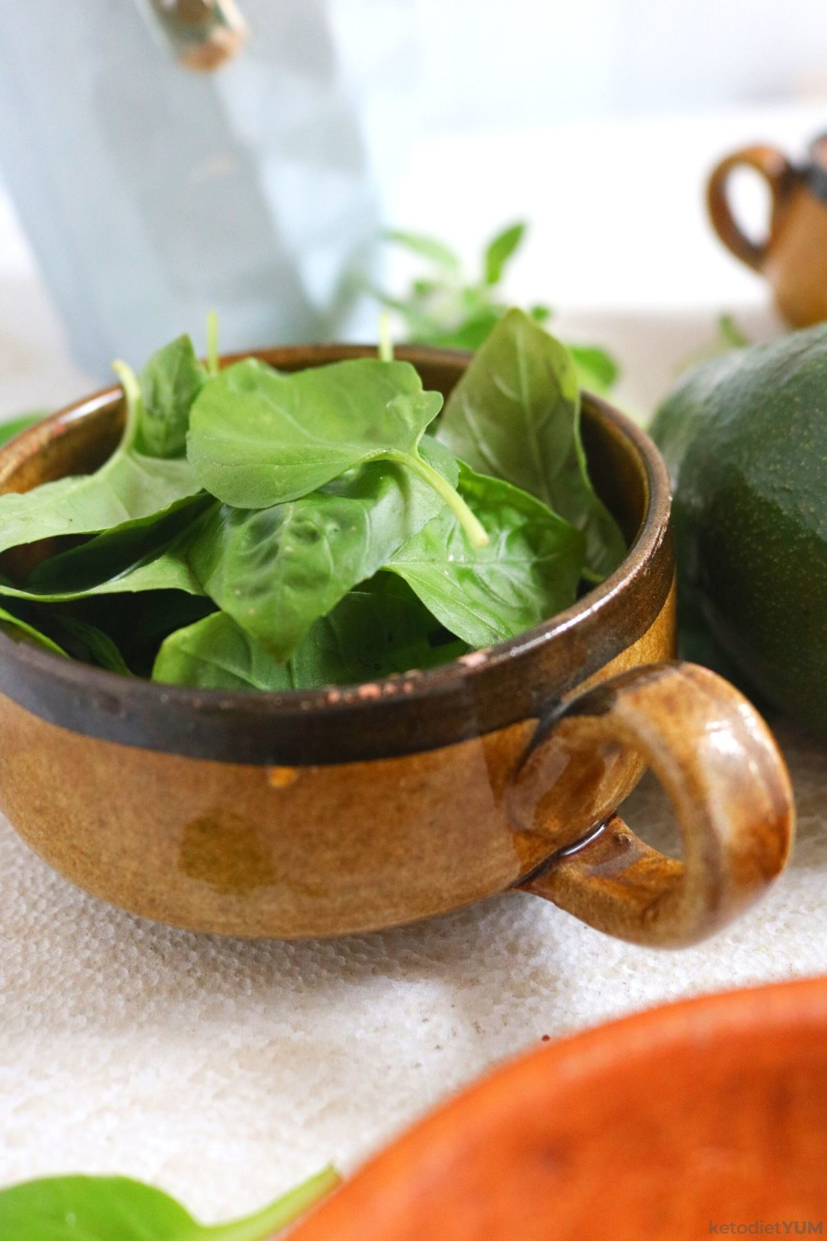 Fresh basil in a bowl ready to chop